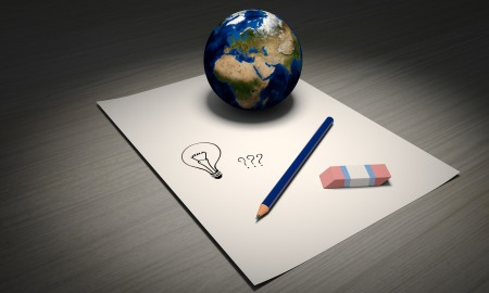 Illustration with a paper with a pencil and rubber, planet earth next to them