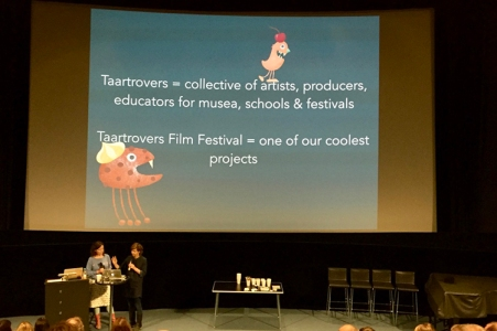 Two women at a stage, illustrations in the background and the name Taartrovers Film festival